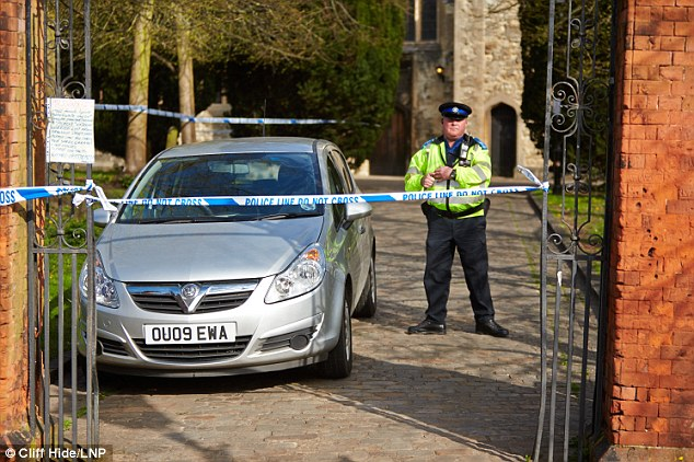 Probe: the police cordon around St Mary's Church in Aylesbury after a severed ear was discovered