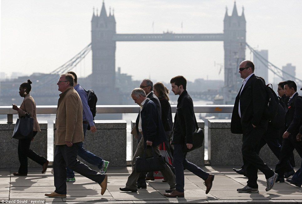 Sun: Commuters walk to work across London Bridge this morning on what could be the hottest day of the year so far