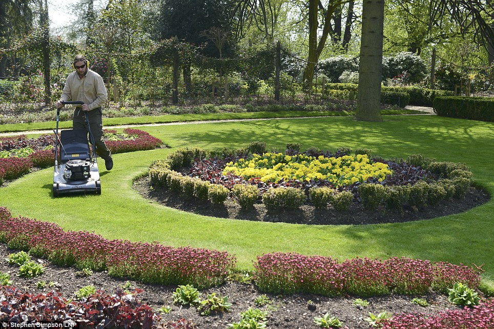 Warm:  A man mows a lawn in the ornamental gardens in Chiswick House, west London