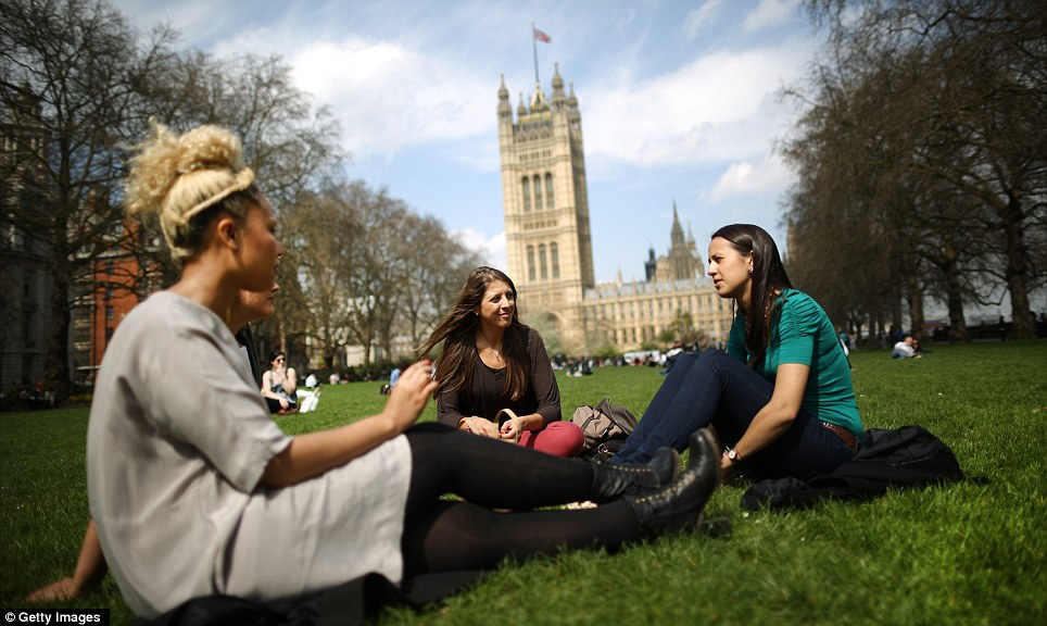 Last of the sun: A group of women enjoy the warm weather today at lunchtime in Victoria Tower Gardens before it gets cooler tomorrow