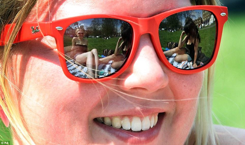 Beautiful day: Melina Teske 21, enjoys the hot weather on Clapham Common in London