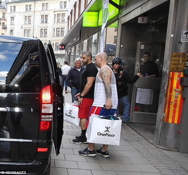 Stocking up: Justin's entourage made a stop at the OnePiece store to pick up some extra pieces
