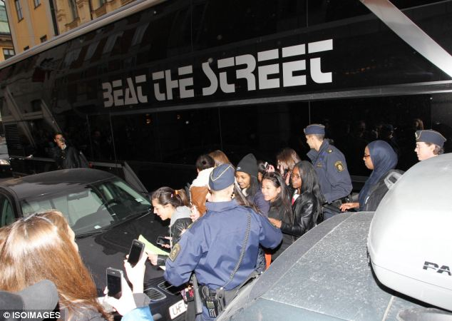 Justin Bieber's bus is pictured during the police raid, where officers allegedly found drugs and a stun gun