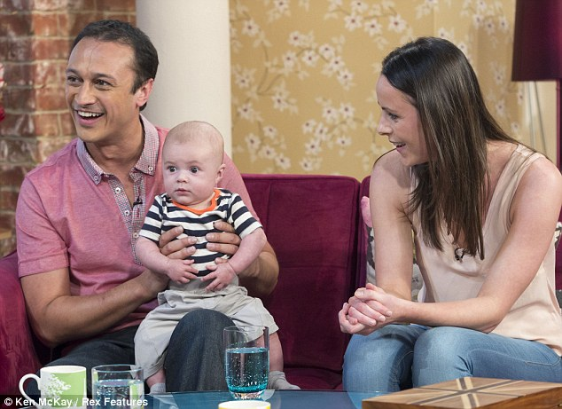 Doting daddy: Emmerdale's Chris Bisson introduced his 15-week-old baby son Harry on This Morning on Thursday, alongside partner Rowena Finn