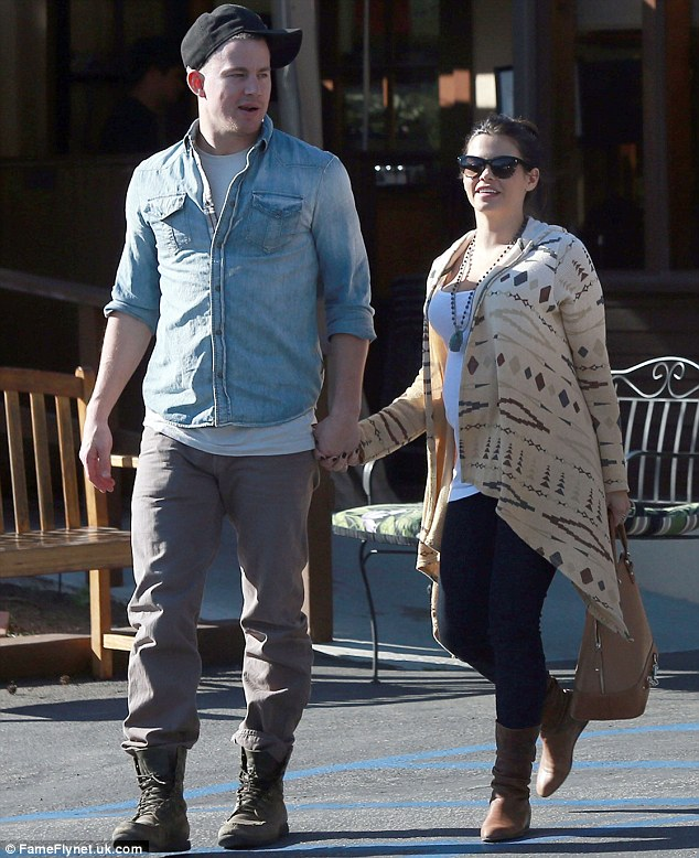 Managing: Though her preferred walking partner, pictured here in February, has been overseas, the actress distracted herself by walking with her two pups