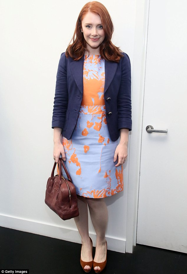 Tangerine dream: Bryce Dallas Howard's orange and lilac dress highlighted her flame red hair at the Women's Filmmaker Brunch in New York on Thursday