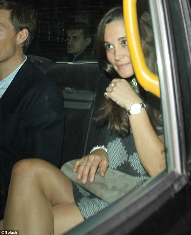 Accessorising: Pippa carried a clutch bag that matched her silver shoes