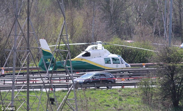 Emergency: Six air ambulances - including this one - were called to the scene and made multiple trips to hospitals with all the passengers