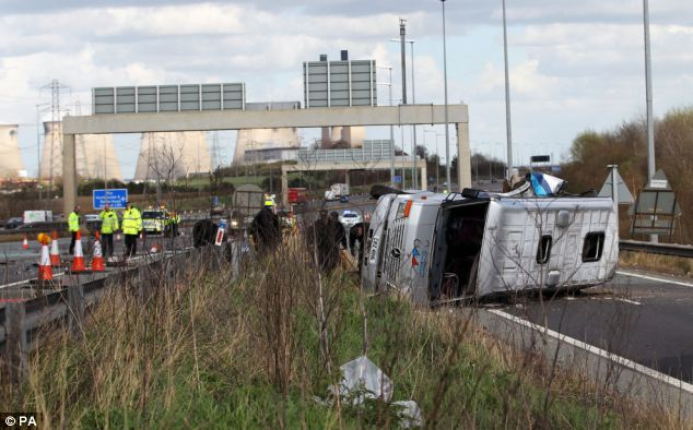 Scene: The minibus turned onto its side after leaving the main carriageway and going up a sliproad when it collided with the Farmfoods lorry
