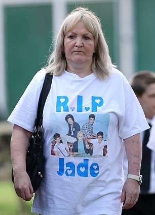 A mourner arrives for the funeral of Jade Anderson, wearing a t-shirt with a picture of One Direction