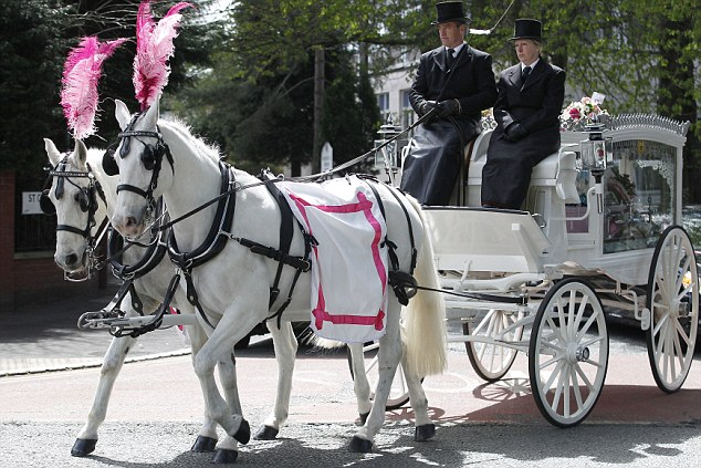 Fitting: The pink coffin of Jade Anderson in a horse drawn carriage that took her from the church today
