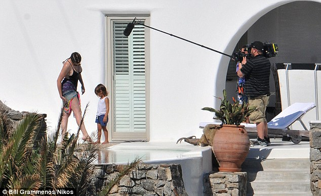 Fun with Auntie: Khloe's chat with Mason by a pool was captured on camera