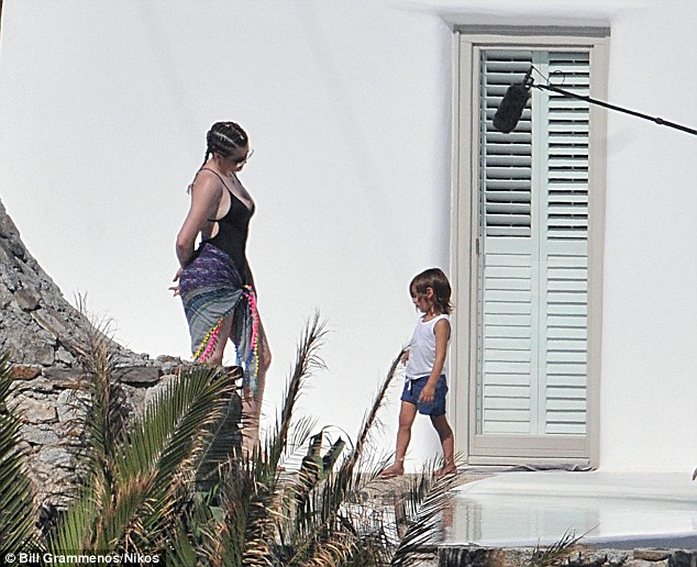 Quality time: Khloe chats to her nephew Mason, which is captured on camera
