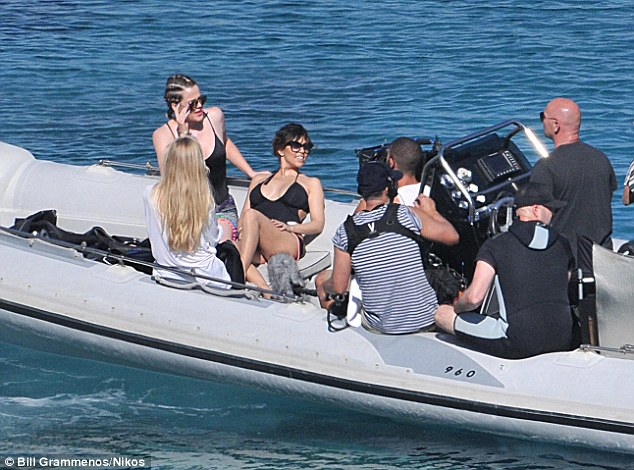 Always on camera: Khloe and Kourtney Kardashian strip down to their swimsuits as they were filmed on a boat trip