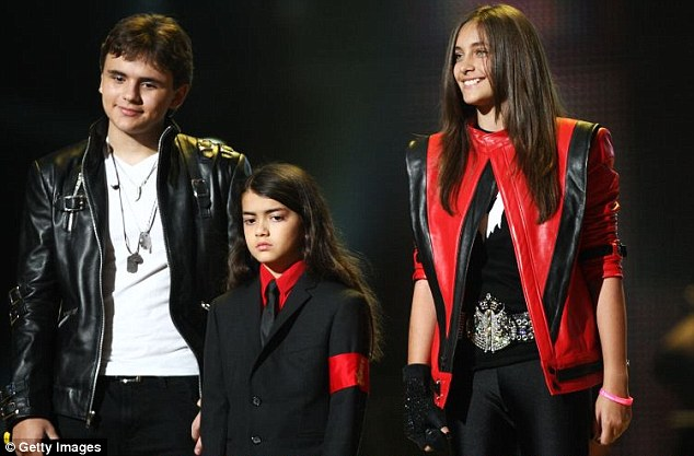 Paying tribute: Prince, Blanket and Paris Jackson appeared onstage at the Michael Forever concert to remember their father at the Millennium Stadium in the UK in 2011