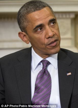 President Barack Obama answers a question regarding the ongoing situation in Syria