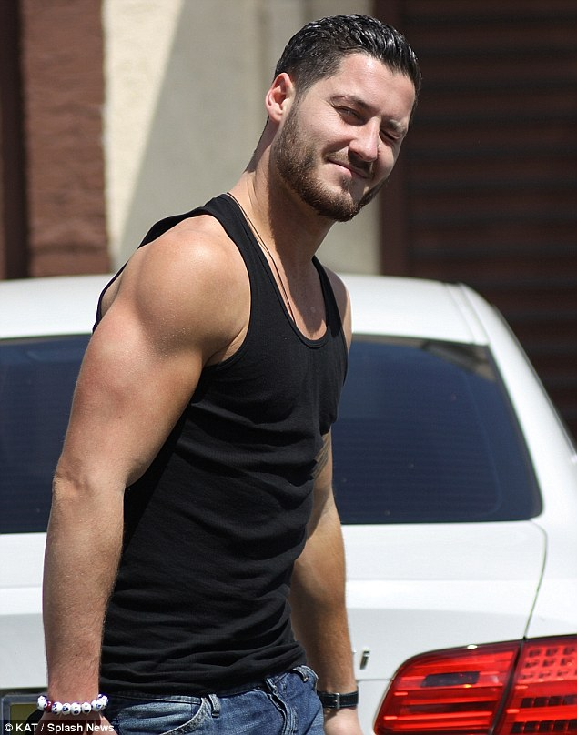 Looking cut: Dancer Val Chmerkovskiy arrived in a black muscle shirt, showing off his muscular arms