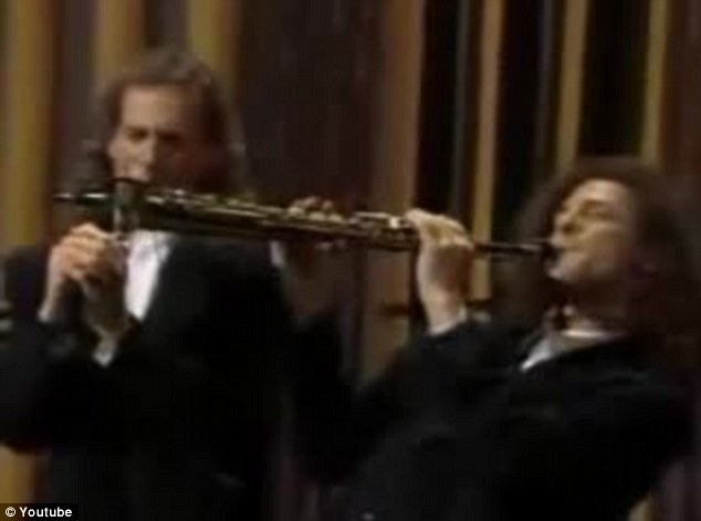 Not quite the same: The version of Kenny G and Michael Bolton's performance has attracted more than 200,000 views on YouTube