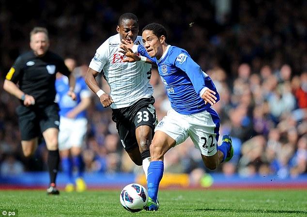 Hand off: Pienaar keeps Fulham's Eyong Enoh at bay as he runs through the midfield