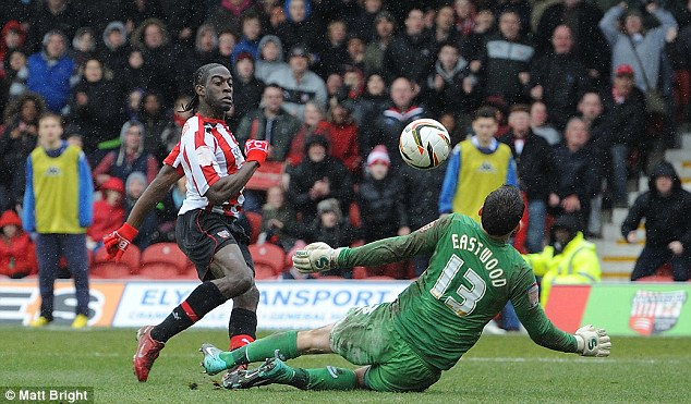 Going for Promotion, part two: Brentford's Clayton Donaldson (left) will hope to stop Paynter and his Doncaster side