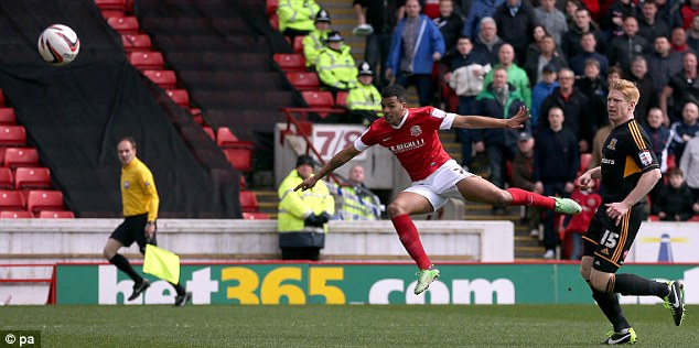 Stunner: Jacob Mellis (left) takes the wind out of Hull City's promotion sails with an early goal for Barnsley