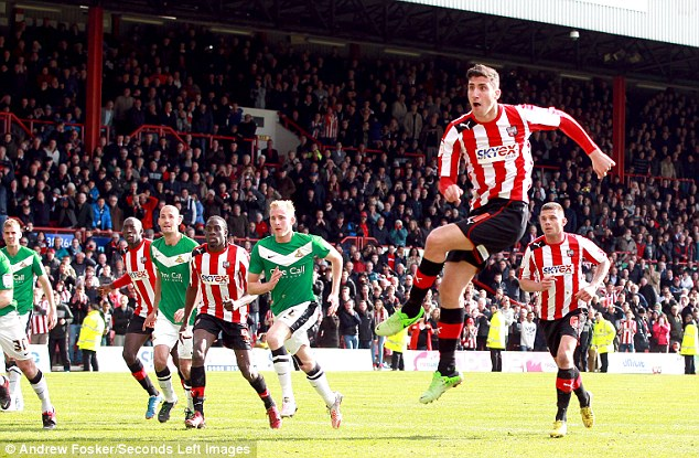 The moment: Marcello Trotta (centre) misses the penalty that could have sent Brentford into the Championship
