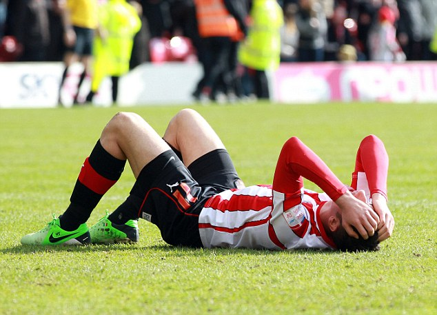 Gutted: Trotta holds his head in his hands after striking the bar from close range