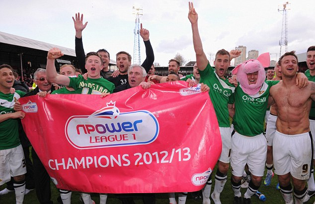 Championship bound: The Doncaster olayers celebrate as champions of League One