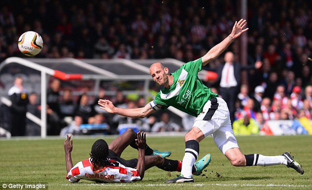 Blockbuster: Doncaster's Rob Jones is tackled by Brentford's Clayton Donaldson
