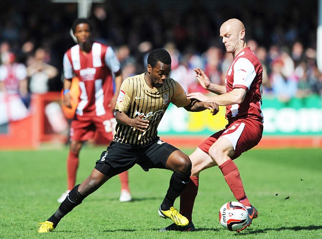 Tussle: Zavon Hines (L) of Bradford City and Jason Taylor of Cheltenham Town in action