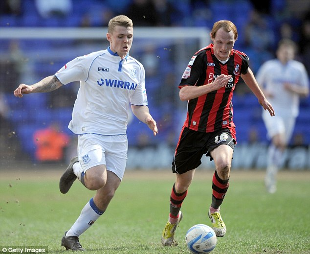 Battle: Max Power (left) carries the ball towards Bournemouth's goal