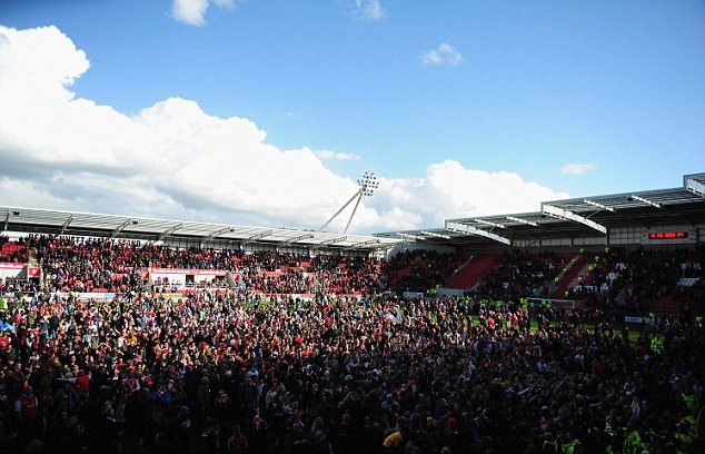 In the mix: Rotherham manager Steve Evans was on the pitch with supporters after the game