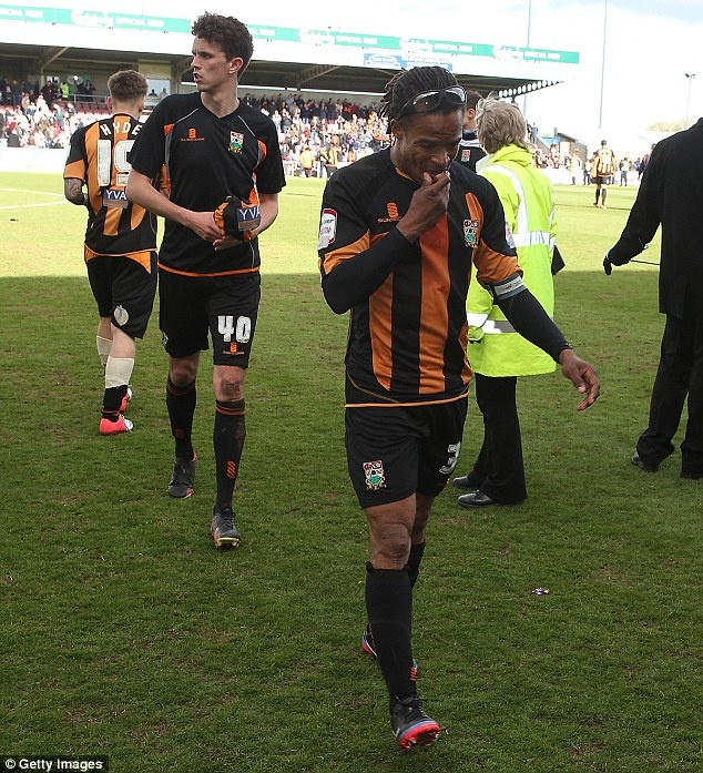 Gutting: Edgar Davids walks off the pitch with his Barnet players after being relegated from the division