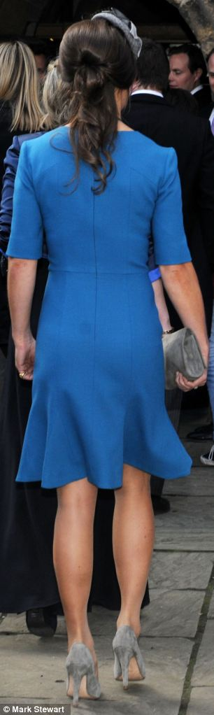 Pippa Middleton looks stunning as she attends the wedding