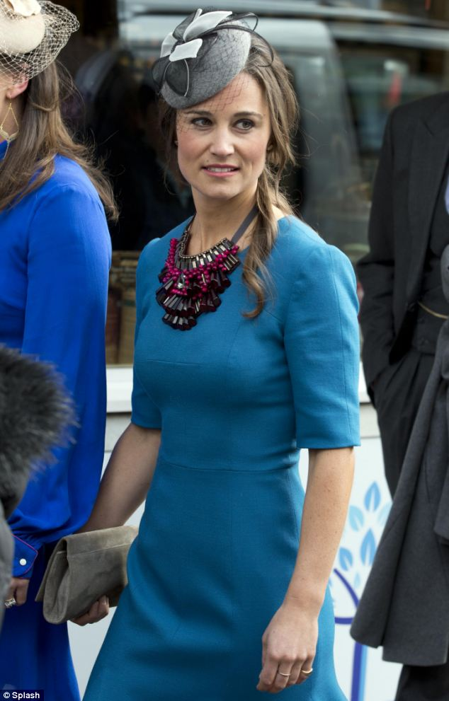 With her hair curled and loosely pinned up, Pippa looked elegant in her striking ensemble