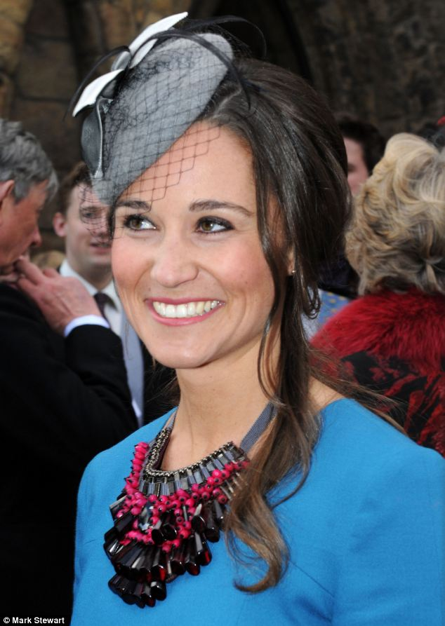 Wedding bells? Pippa, sporting a bright outfit, beamed after the ceremony in Northumberland