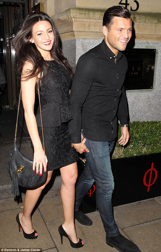 Colour coordinated: Michelle Keegan and Mark Wright looked like they had their styles in sync as they had a romantic date night at Rosso Restaurant on Friday night