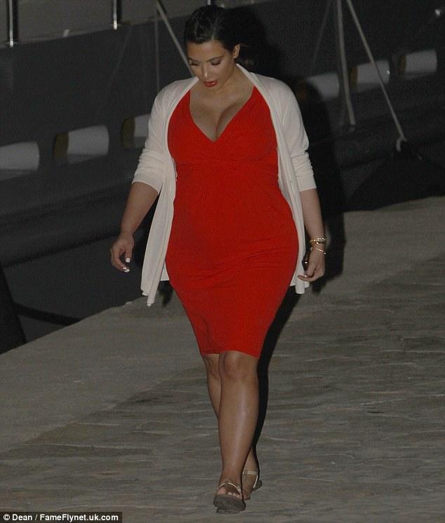 Kim Kardashian keeps her maternity wardrobe bold as she goes for a bright red dress in Mykonos on Saturday
