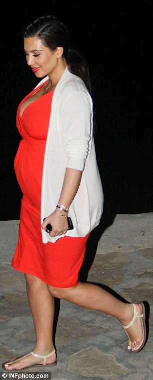 Kim looked positively glowing as she enjoys one last pre-baby holiday with her family
