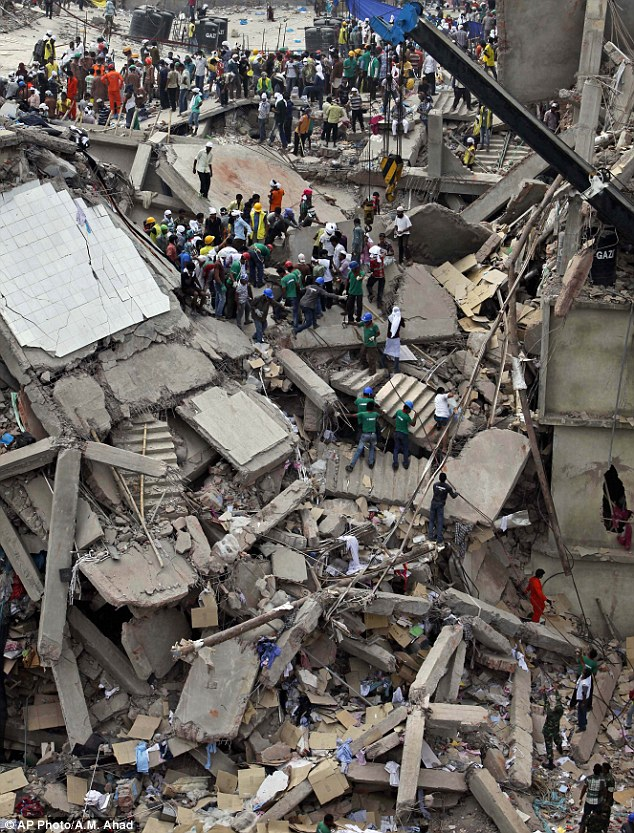 Horrific: More than 1,100 workers were killed and hundreds more injured when a block of factories at Rana plaza in Dhaka collapsed back in April