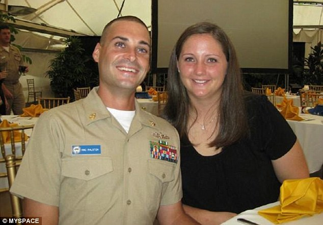 American hero: Eric Ralston, pictured with his wife, Jennifer, serves in the US Navy as chief hospital corpsman aboard USS Frank Cable, stationed in Guam