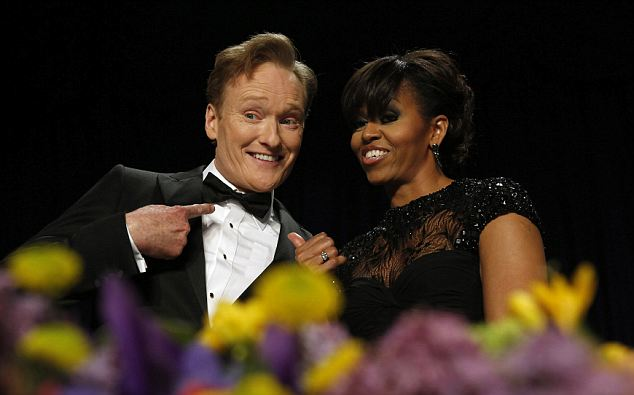 No nerves? Comedian Conan O'Brien poses with U.S. first lady Michelle Obama during the White House Correspondents Association Dinner