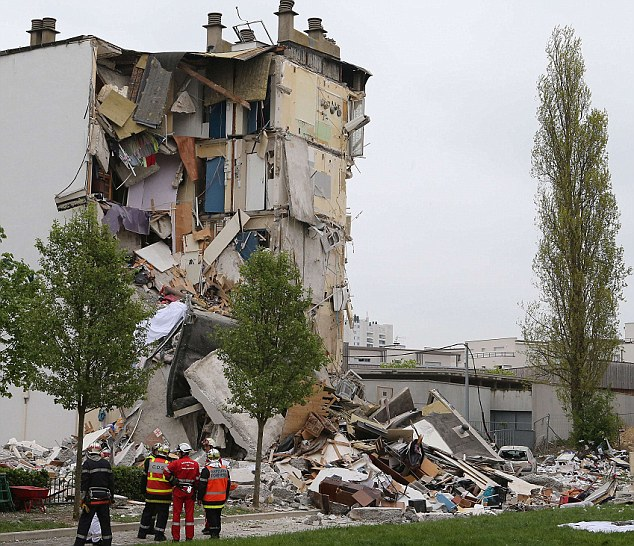 Aftermath: Two people have been killed and at least nine others injured after an explosion caused part of a building to collapse in Reims, France