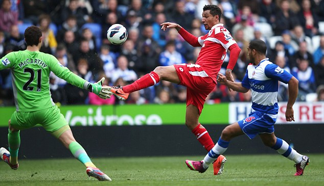 Going close: Jay Bothroyd (centre) lifted a shot wide of the post for QPR