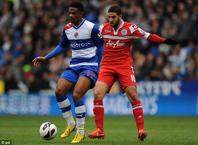 Contest: Reading's Garath McCleary (left) and QPR's Adel Taarabt fight for the ball