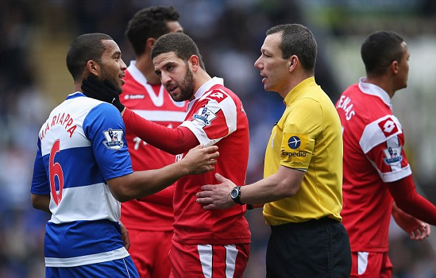 Tension: QPR's Adel Taarabt (centre) confronts Reading's Adrian Mariappa