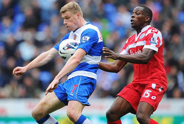 Under control: Reading's Pavel Pogrebnyak brings the ball down in front of QPR's Stephane Mbia