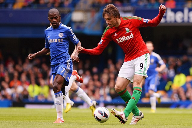 Playing the pass: Swansea's Michu plays the ball in front of Chelsea's Ramires