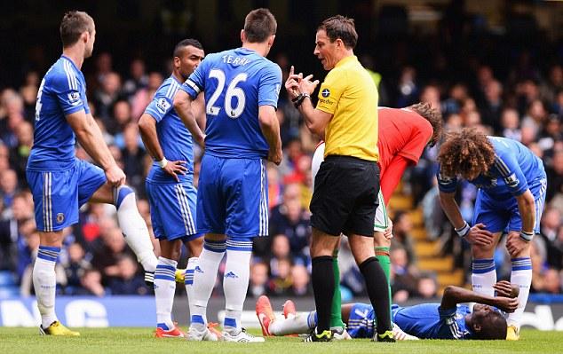 Talking point: Referee Mark Clattenburg addresses Chelsea skipper John Terry
