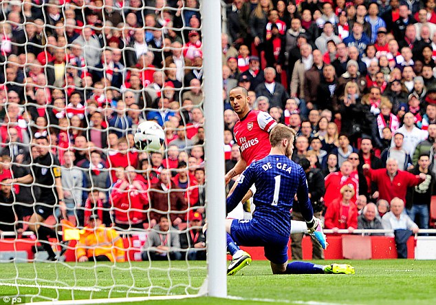 Quick out the blocks: Theo Walcott sneaked in behind the United defence to fire Arsenal ahead